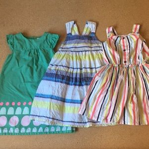 Three girls' dresses